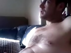 Dishy man is having fun at one's disposal home plus filming himself on the top of computer webcam